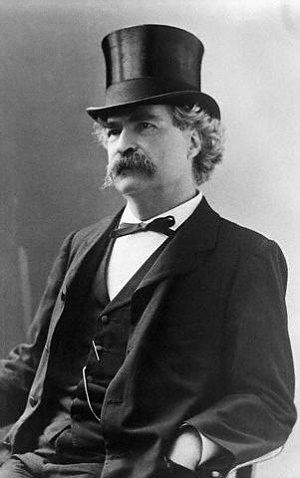 Original Caption: Mark Twain in tophat, ca. 1890.